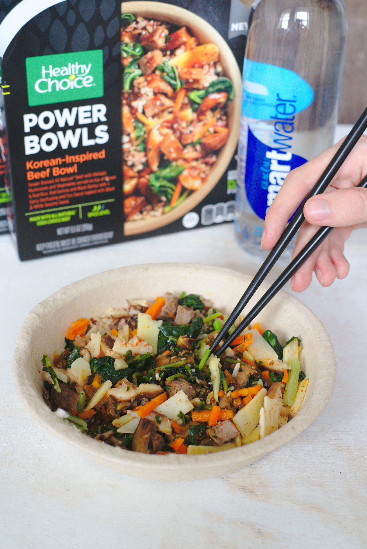 Chopsticks in Healthy Choice Korean-Inspired Beef Bowl with smartwater