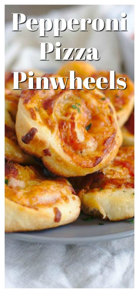 Pizza Pinwheels - A quick and easy appetizer! Pizza dough filled with marinara sauce, mozzarella, parmesan, and pepperoni and baked until golden brown. The ultimate pinwheel recipe! Pizza Appetizer   Pinwheel Recipe   Pepperoni Pizza Recipe